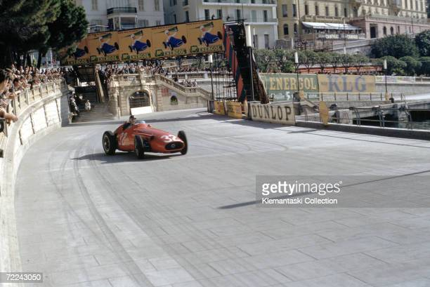 Maserati driver Juan Manuel Fangio in a full power drift at the exit of the Tabac during the Monaco Grand Prix, Monte Carlo, 19th May 1957. Fangio...