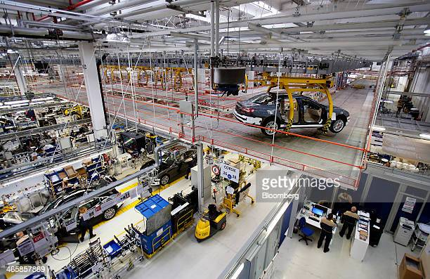 Maserati Ghibli luxury automobiles produced by Maserati SpA travel along the semiautomated production line at Fiat SpA's Grugliasco factory in Turin...