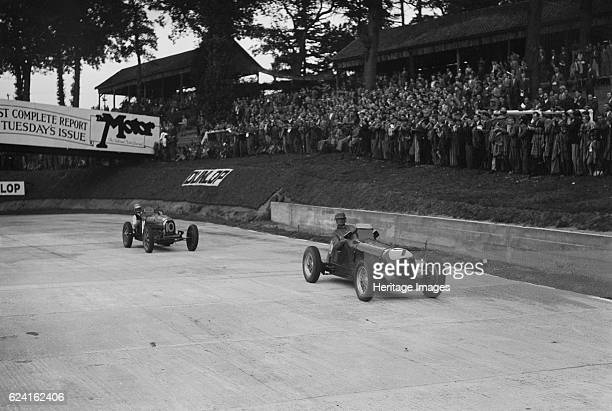 Maserati leading Charles Mortimer's Bugatti Type 35B at Brooklands Surrey 1939 Artist Bill BrunellRight Maserati Event Entry No 7 Left Bugatti Type...