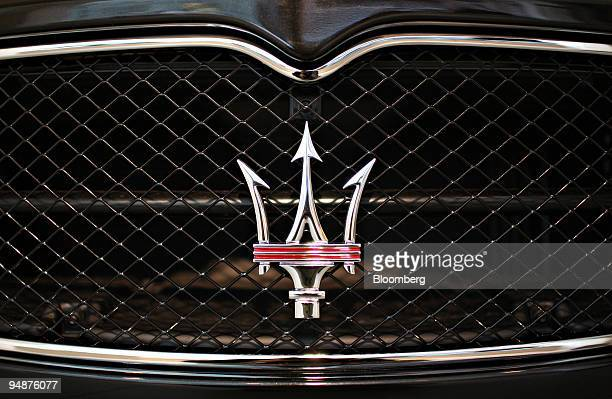 Maserati logo appears on the front grille of a 2009 GranTurismo S in the Ferrari Maserati showroom in New York US on Tuesday March 18 2008 The...