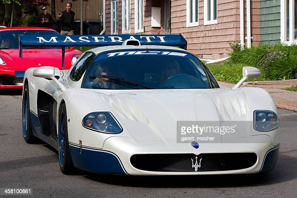 maserati mc-12 driving in downtown charlottetown, pe - maserati stock pictures, royalty-free photos & images