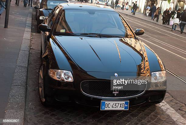 maserati quattroport on streets of rome - maserati stock pictures, royalty-free photos & images