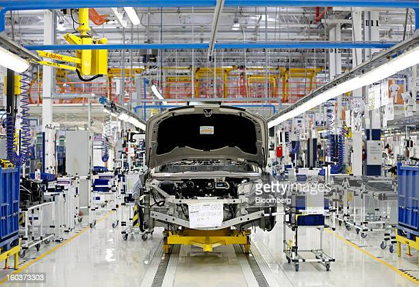 A Maserati Quattroporte luxury automobile stands on the production line at Fiat SpA's Grugliasco factory in Turin Italy on Wednesday Jan 30 2013 Fiat...