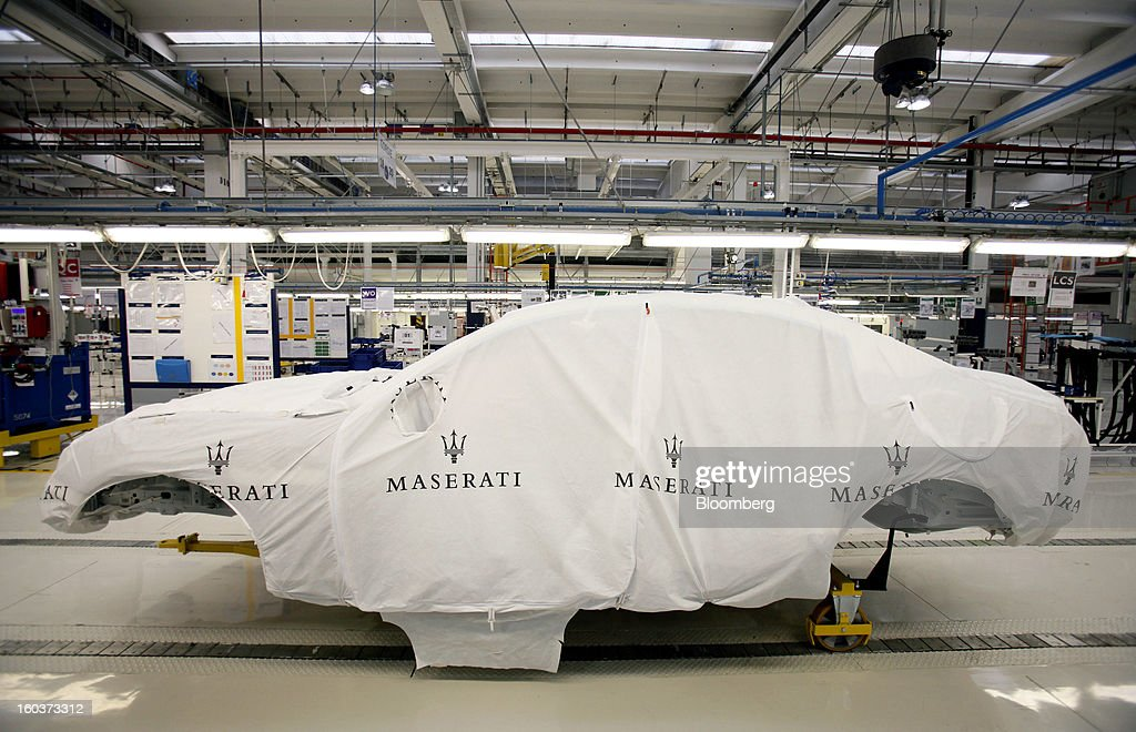 A Maserati-branded protective cover sits on the bodyshell of a Quattroportre luxury automobile on the production line at Fiat SpA's Grugliasco factory in Turin, Italy, on Wednesday, Jan. 30, 2013. Fiat SpA Chief Executive Officer Sergio Marchionne said the Italian carmaker narrowed losses in Europe in the fourth quarter, helping it achieve full-year earnings that were in line with its forecasts. Photographer: Alessia Pierdomenico/Bloomberg via Getty Images