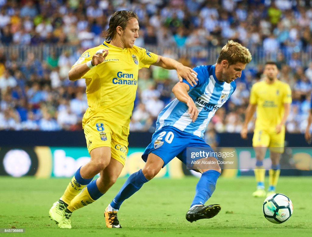 maSergio Gontan 'Keko' being followed by Allen Halilovic of Union Deportiva Las Palmas (L) during the La Liga match between Malaga and Las Palmas at Estadio La Rosaleda on September 11, 2017 in Malaga, .