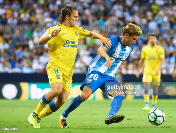 maSergio Gontan 'Keko' being followed by Allen Halilovic of Union Deportiva Las Palmas during the La Liga match between Malaga and Las Palmas at...