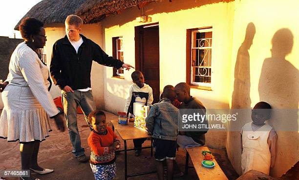 Prince Harry listens to Lydia Muso of the Lesotho children's counsellling unit near to the capital of Maseruwhile on a return visit to Lesotho in...