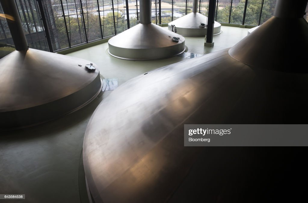Mash tuns stand at the Asahi Kanagawa Brewery, operated by Asahi Breweries Ltd., a unit of Asahi Group Holdings Ltd., in Minamiashigara, Kanagawa, Japan, on Monday, Feb. 20, 2017. Asahi, Japan's largest beermaker, is looking to exit its 19.9 percent stake in Tsingtao Brewery Co. after eight years. Photographer: Tomohiro Ohsumi/Bloomberg via Getty Images