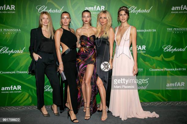 Masha Hanson Model Kristina Romanova and Victoria Lopyreva pose with guests as they attend the amfAR Paris Dinner 2018 at The Peninsula Hotel on July...
