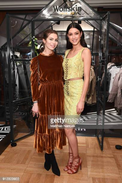 Masha Sedgwick and Rebecca Mir attend the Wolfskin Tech Lab x Gianni Versace retrospective opening event at Kronprinzenpalais on January 30 2018 in...