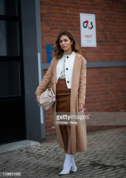Masha Sedgwick is seen wearing beige coat brown skirt Loewe bag white ankle boots outside Munthe during the Copenhagen Fashion Week Autumn/Winter...