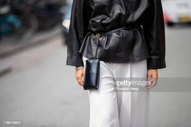 Masha Sedgwick is seen wearing black leather jacket, Jil Sander bag outside Holzweiler during Copenhagen Fashion Week Spring/Summer 2020 on August...