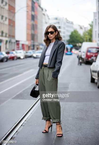 Masha Sedgwick is seen wearing olive green pants Munthe, high heels Aldo, grey cropped blazer MM6, shirt Topshop, black bag Lili Radu, sunglasses...