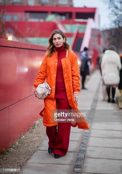 Masha Sedgwick is seen wearing orange coat red turtleneck outside Baum und Pferdgarten during the Copenhagen Fashion Week Autumn/Winter 2019 Day 3 on...