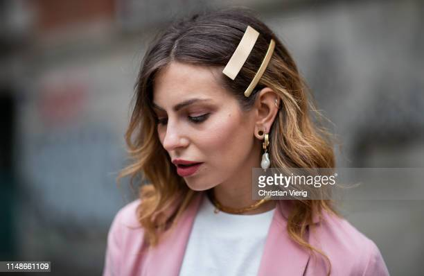 Masha Sedgwick is seen wearing pink blazer Iris Ink white Jacquemus tshirt hair clip earrings on May 11 2019 in Berlin Germany