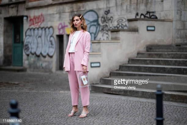 Masha Sedgwick is seen wearing pink blazer, suit and pants Iris & Ink, white Jacquemus tshirt, see through bag Topshop, Sandro sandals, hair clip,...