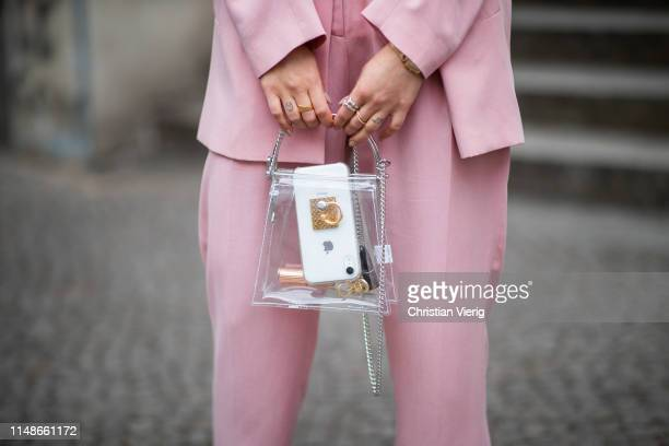 Masha Sedgwick is seen wearing pink blazer, suit and pants Iris & Ink, white Jacquemus tshirt, see through bag Topshop earrings on May 11, 2019 in...
