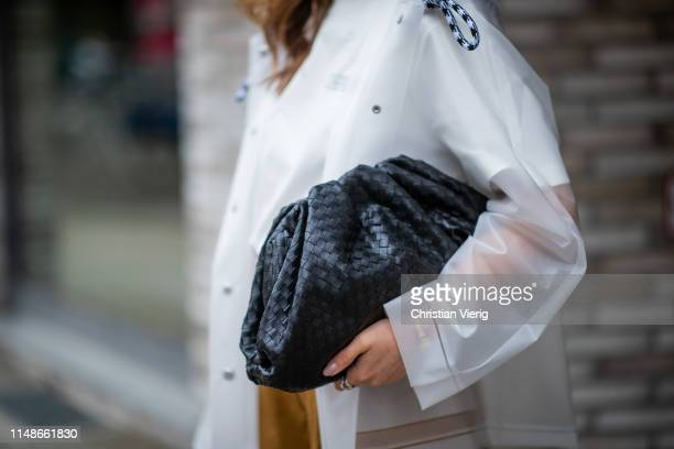Masha Sedgwick is seen wearing see through sheer Proenza Schouler rain jacket, white tshirt Calvin Klein, black clutch Bottega Veneta on May 11, 2019...