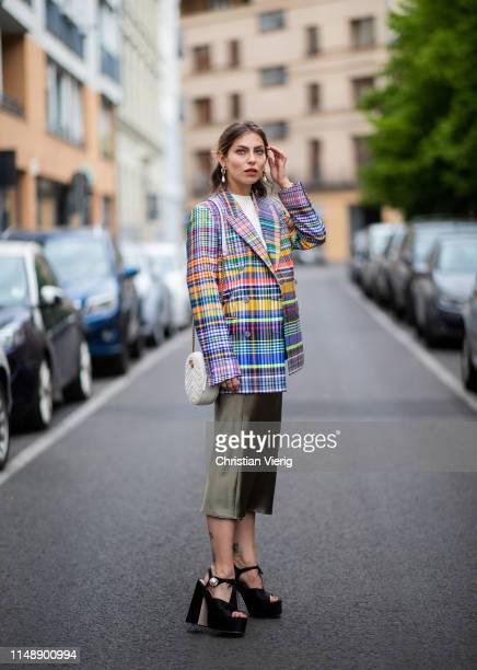 Masha Sedgwick is seen wearing white tshirt Calvin Klein, checked multi colored blazer Dries van Noten, green silk Topshop midi skirt, Miu Miu high...