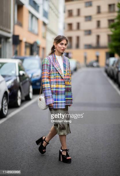 Masha Sedgwick is seen wearing white tshirt Calvin Klein checked multi colored blazer Dries van Noten green silk Topshop midi skirt Miu Miu high...