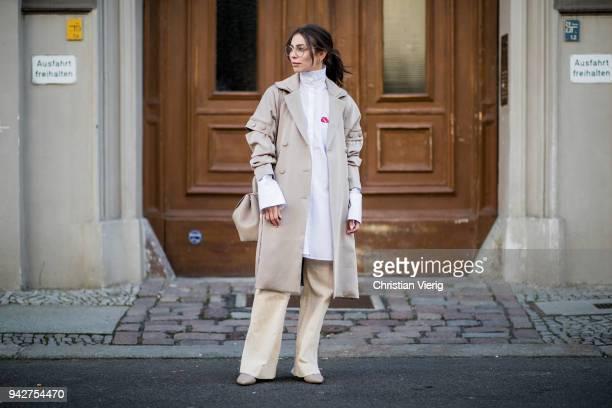 Masha Sedgwick wearing a beige trench coat Gestuz a white button shirt Lala Berlin vintage glasses Polene hand bag Agl pointed shoes beige HM pants...
