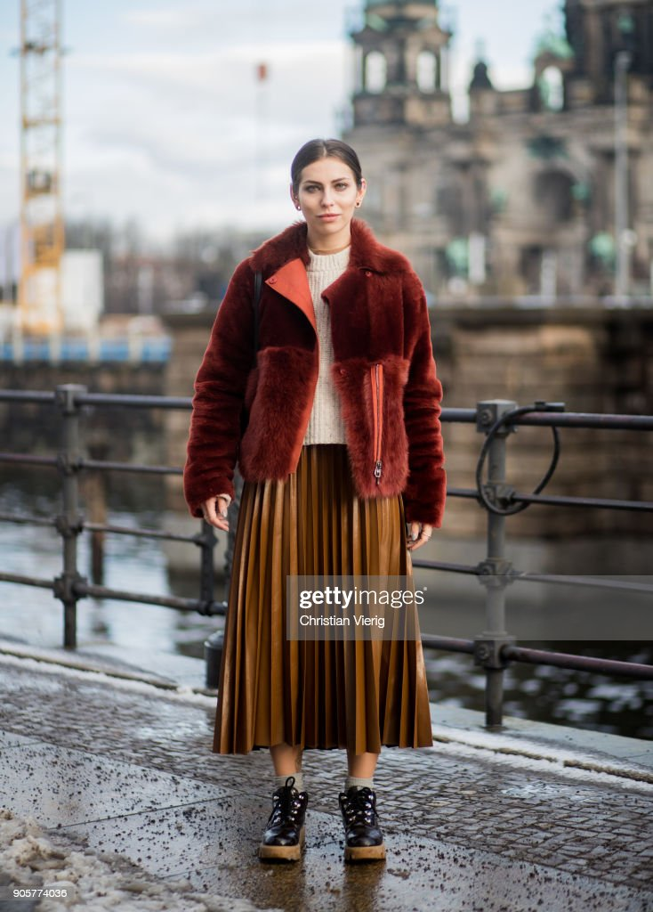 Masha Sedgwick wearing Acne boots, Strenesse lambskin jacket, H&M pleated skirt, Celine bag is seen during the Berlin Fashion Week January 2018 at Bauakademie on January 16, 2018 in Berlin, Germany.
