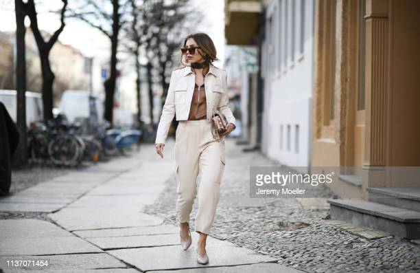 Masha Sedgwick wearing Arket silk blouse, Military beige pants via Massimo Dutti, 8 by yoox vinyl jacket, Jimmy Choo bag, Asos sunnies, Yuul Yie...