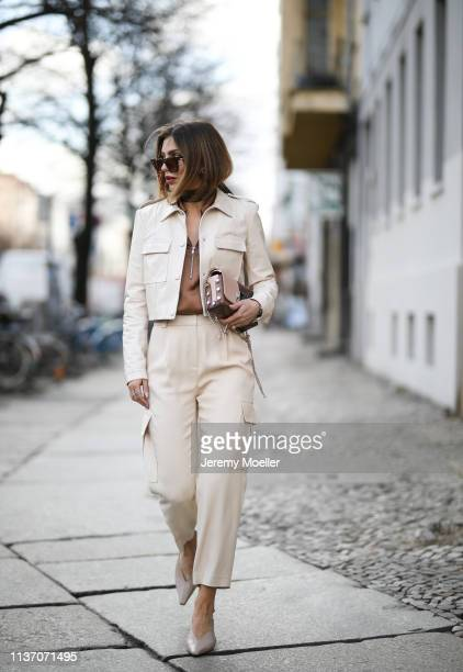 Masha Sedgwick wearing Arket silk blouse Military beige pants via Massimo Dutti 8 by yoox vinyl jacket Jimmy Choo bag Asos sunnies Yuul Yie pumps on...