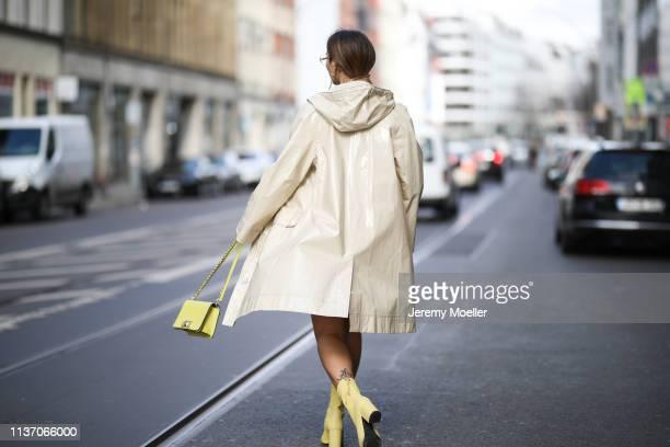 Masha Sedgwick wearing Arket white knit shirt Pinko white leather skirt yellow Furla bag yellow Anine Bing Celine glasses Tiffany Co earring 8 by...