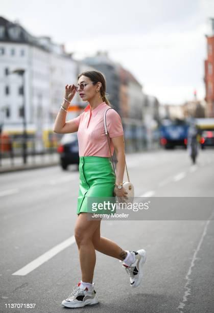 Masha Sedgwick wearing Asos pink blazer Bally pink polo shirt Sandro grass green leather skirt round white Gucci bag Iro Dad Sneakers Yun sunnies...