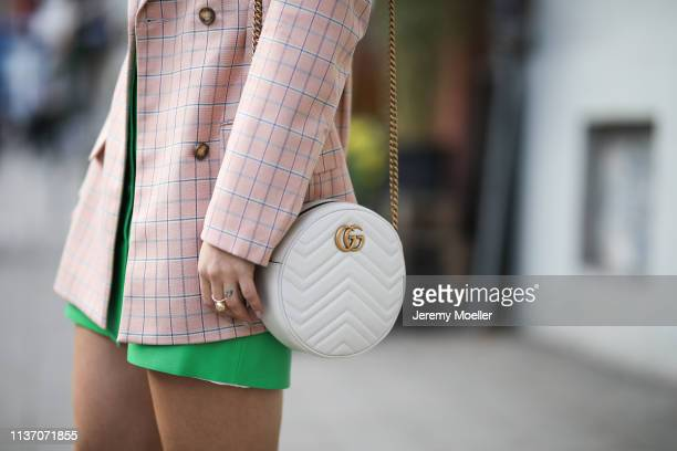 Masha Sedgwick wearing Asos pink blazer Bally pink polo shirt Sandro grass green leather skirt round white Gucci bag Yun sunnies on March 19 2019 in...