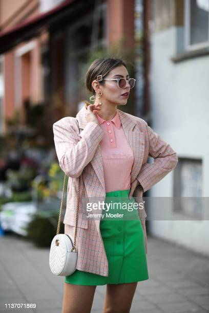 Masha Sedgwick wearing Asos pink blazer Bally pink polo shirt Sandro grass green leather skirt round white Gucci bag Yun sunnies hair pin via Asos on...