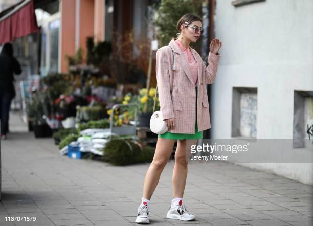Masha Sedgwick wearing Asos pink blazer, Bally pink polo shirt, Sandro grass green leather skirt, round white Gucci bag, Iro Dad Sneakers, Yun...