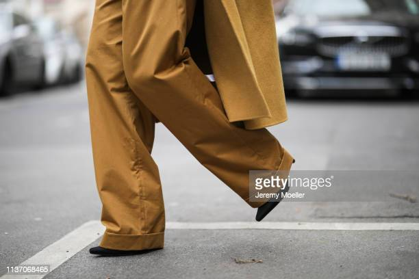 Masha Sedgwick wearing Bally wide pants on March 19 2019 in Berlin Germany
