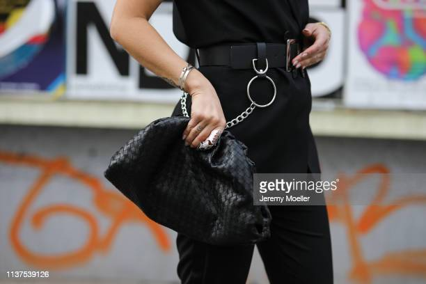 Masha Sedgwick wearing black Bash vest Asos Utility belt black Bottega Veneta Daniel Lee clutch black straight Strenesse pants Vintage ring on March...