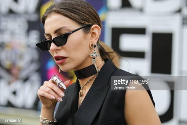 Masha Sedgwick wearing black Bash vest, Asos Utility belt, black Bottega Veneta Daniel Lee clutch, Thomas Sabo necklace, Vintage ring, Zara earrings...