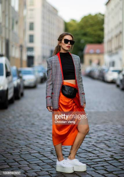 Masha Sedgwick wearing black cropped top Asos orange skirt with slit Sies Marjan black belt bag Gabriele Frantzen Superga platform sneakers Lala...