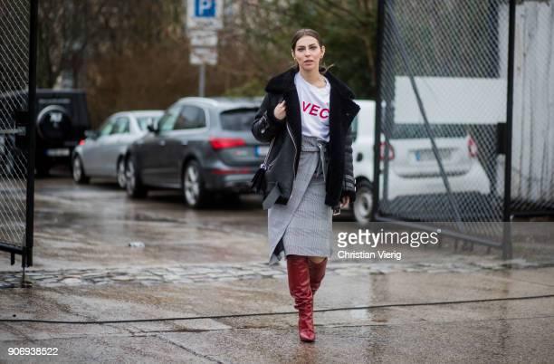 Masha Sedgwick wearing black jacket red boots white tshirt grey midi skit is seen outside Marina Hoermanseder during the Berlin Fashion Week January...