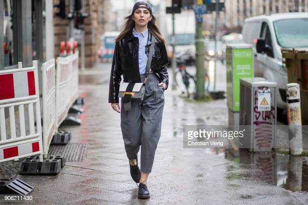 Masha Sedgwick wearing black jacket Topshop grey pants Topshop Dr Martens shoes Prada bag Tommy Hilfiger button shirt is seen outside Lana Mueller...