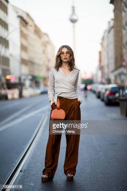Masha Sedgwick wearing blouse Massimo Dutti, H&M pants, Tory Burch platform sandals, Polene bag, Chloe sunglasses on July 31, 2018 in Berlin, Germany.