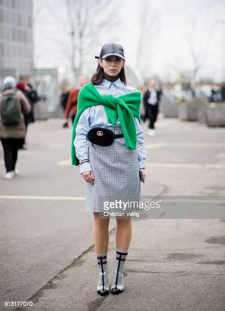 Masha Sedgwick wearing cap Gucci belt bag grey skirt button shirt ankle boots outside Designers Remix during the Copenhagen Fashion Week...
