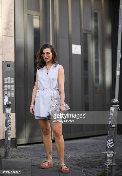 Masha Sedgwick wearing Charles Kith shoes, Gestuz bag and Cos dress on May 06, 2020 in Berlin, Germany.