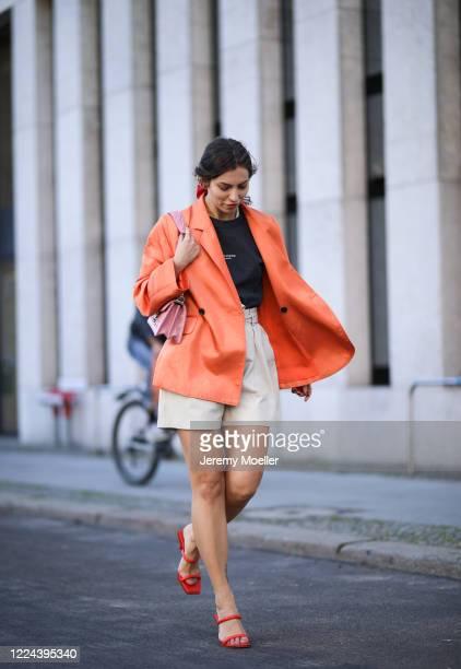 Masha Sedgwick wearing Copenhagen Muse pants, Acne Studios shirt, Baum & Pferdgarten Blazer, Charles & Knith heels and Miu Miu bag on May 06, 2020 in...