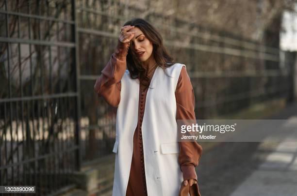 Masha Sedgwick wearing Envelope 1976 brown dress, Zara beige vest on February 22, 2021 in Berlin, Germany.