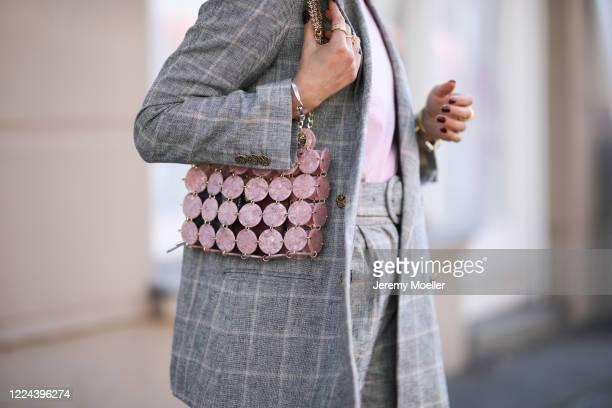 Masha Sedgwick wearing Envii shirt and Sandro jacket and bag on May 06, 2020 in Berlin, Germany.