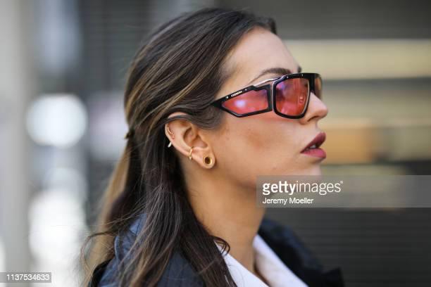 Masha Sedgwick wearing Fay Rain Coat white Lacoste polo shirt Givenchy earring on March 20 2019 in Berlin Germany
