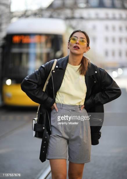 Masha Sedgwick wearing Gestuz citrus light yellow shirt, Acne Studio oversized leather jacket, grey Frankie shop shorts, Sandro yellow bag, yellow...