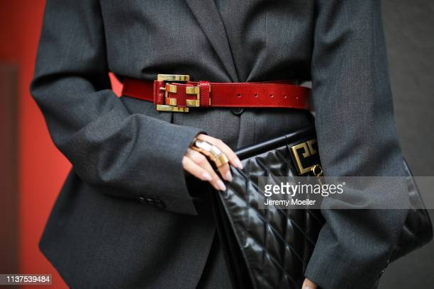 Masha Sedgwick wearing grey ami oversized blazer Givenchy clutch Vintage belt Tiffany earrings on March 20 2019 in Berlin Germany