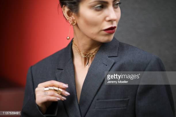 Masha Sedgwick wearing grey ami oversized blazer, Thomas Sabo necklace, Tiffany earrings on March 20, 2019 in Berlin, Germany.