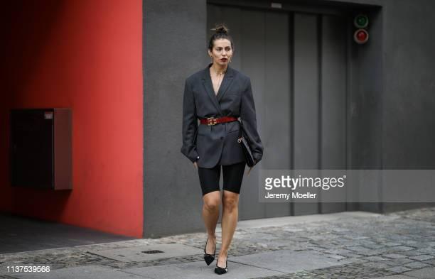 Masha Sedgwick wearing grey ami oversized blazer Thomas Sabo necklace Givenchy clutch Topshop cycling shorts Vintage belt Tiffany earrings Karl...